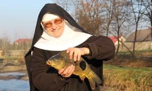 Sister Stefania holding one of her Christmas carp.