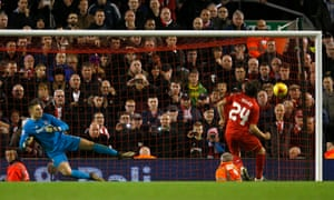 Joe Allen of Liverpool sends Stoke's goalkeeper Jack Butland the wrong way for his side's winning penalty.