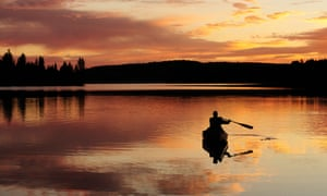 Paddling a canoe on a lake in Algonquin Provincial Park, Ontario, Canada