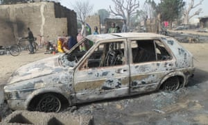 A burned-out car in Nigeria after a Boko Haram attack