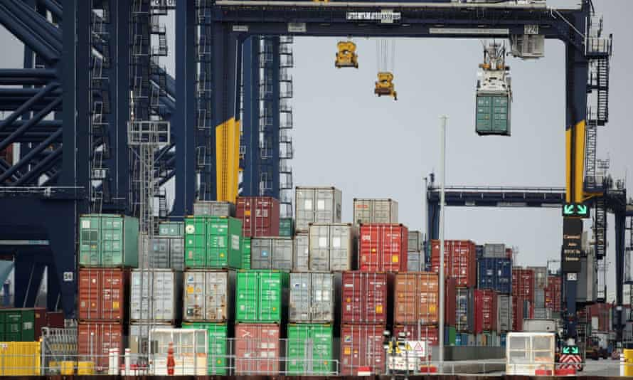 Containers being stacked in automated process at the port of Felixstowe, Suffolk