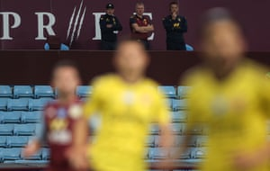 Dean Smith and John Terry watch from the stand.