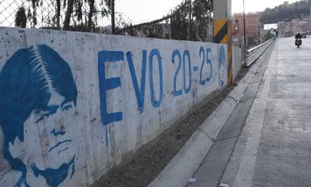 A graffiti of the former president Evo Morales in La Paz. The exiled Morales still overshadows Bolivian politics.
