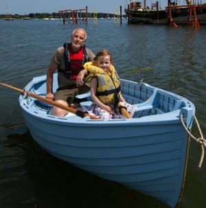 Jonathan Gornall and his daughter Phoebe in a boat