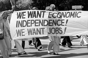 "A banner reading ""we want economic independence, we want jobs!"" at a rally in sydney"