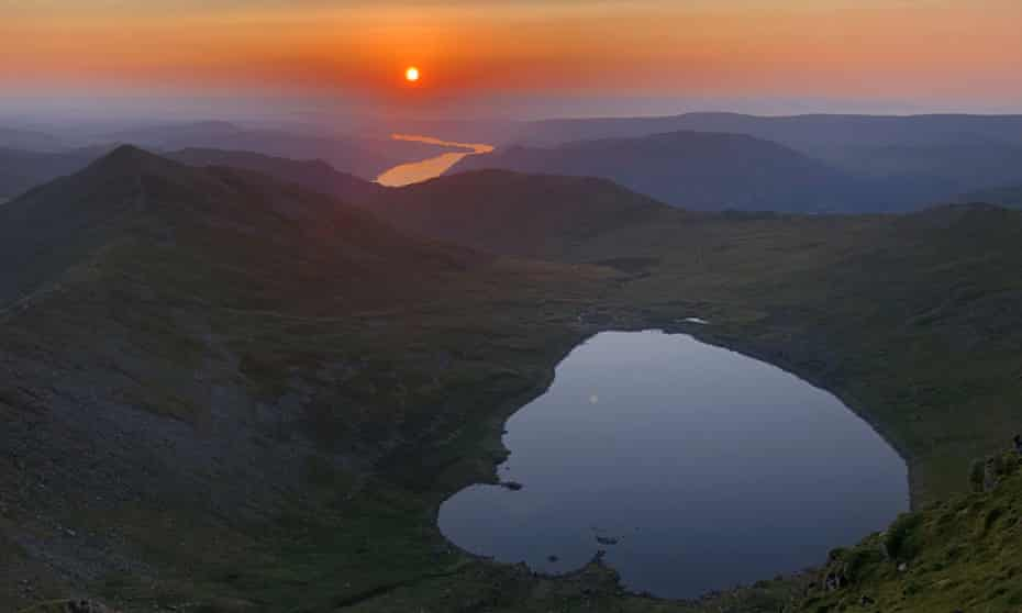 The sun rising over Red Tarn, seen from the top of Helvellyn.