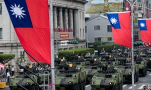 Armoured vehicles parade in front of Taiwan's Presidential Palace in downtown Taipei on the occasion of the 105 years celebration of the founding of the Republic of China.