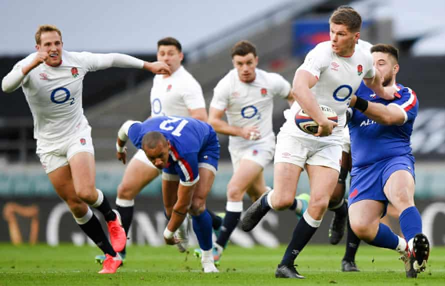 England's Owen Farrell evades the challenges of two French opponents during their Six Nations win.