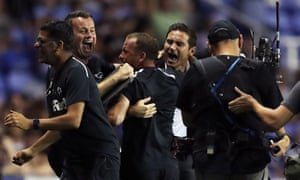 Frank Lampard celebrates Derby's win with his staff.
