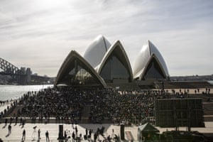 A large crowd gathers outside the Sydney Opera House for the Bob Hawke memorial service.