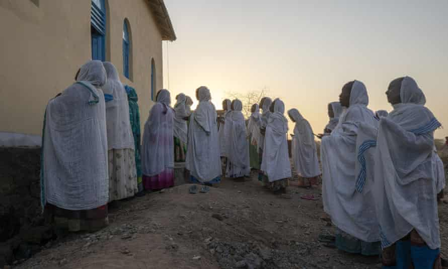 Orthodox Christian refugees who fled the conflict in Tigray pray at a camp in Hamdeyat near the Sudan-Ethiopia border.
