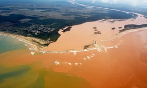 Mining waste released by the Samarco dam burst in Brazil flows from the mouth of the Rio Dolce river into the Atlantic ocean.