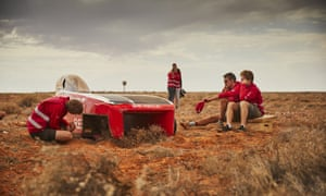 Members of Solar Team Twente with their crashed car on Wednesday.