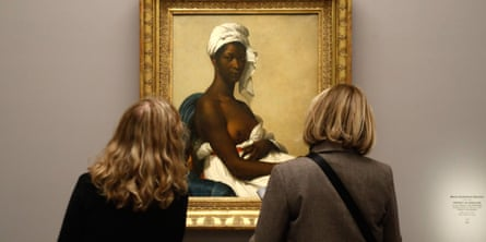 Visitors look at the painting Portrait de Madeleine (1800), by French painter Marie-Guillemine Benoist.