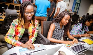 Two women work on projects at Andela's all-female boot camp in Lagos, Nigeria