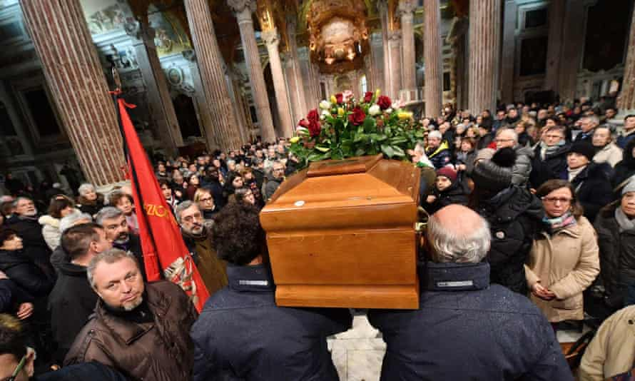 People attend the funeral of Prince Jerry in Genoa