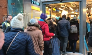 People queuing outside Primark store