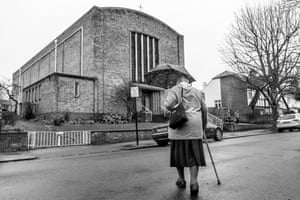 Monica Blair attends Sunday service at St James church in Clapham, from Windrush generation portraits by Jim Grover