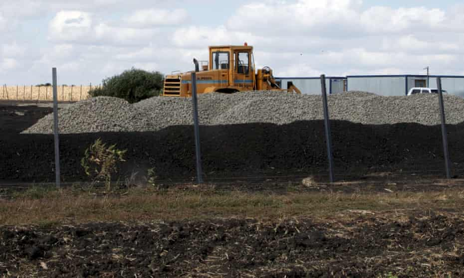 An excavator at a construction site for Russia's new military base near the Ukrainian border.