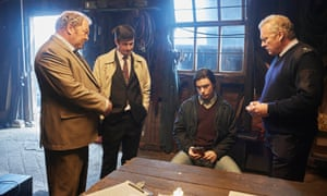 A scene from ITV's White House Farm with Freddie Fox (seated) as Jeremy Bamber.