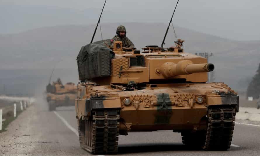 Turkish army tanks on the move near the Syrian border.