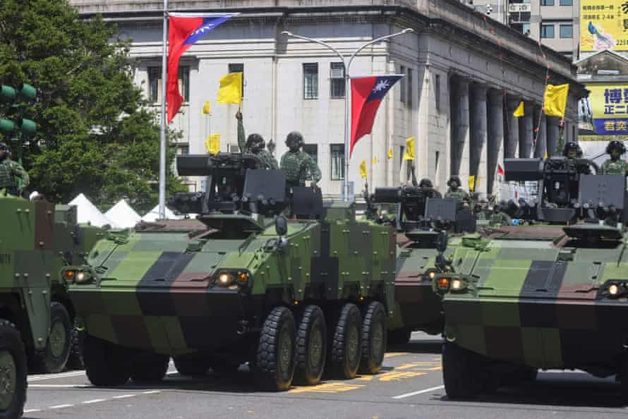 Army vehicles participate in national day celebrations in Taipei.