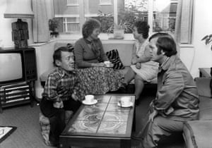 Kenny Baker and Jack Purvis of The Mini-tones theatre group are pictured with their wives at Baker's home