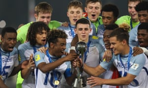 The Englands admire the trophy.
