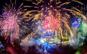 Fireworks erupt over the Chao Phraya river in Bangkok, Thailand