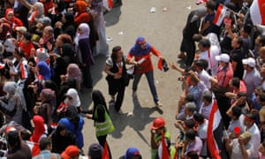 Volunteers form a safe zone between men and women to prevent sexual harassment during a protest against the then president, Mohamed Morsi, in Tahrir Square in Cairo, Egypt, July 2013.