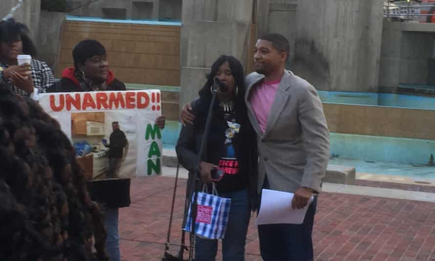 Tawanda Jones and Abdul Salaam at a protest over Tyrone West's death.