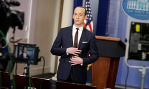 Stephen Miller waits to go on the air in the White House briefing room in Washington on Sunday.