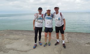Living on the edge: Martin Love with friends Tom and Alan on their run around the Isle of Wight