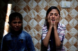 Palestinian relatives of Hamas gunman Mohammed Hejelah, who was killed by an Israeli air strike, mourn during his funeral in Gaza.