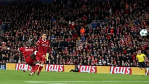 Mane belts a volley to score the fourth for Liverpool.