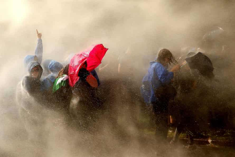 Demonstrators are hit by water cannon during the Welcome to Hell protest in Hamburg.