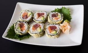 Six tempura roll on an oblong white plate