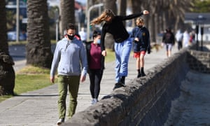 A family exercises along Port Melbourne Beach in Melbourne on 10 August 2020, as the city struggles to cope with a Covid-19 coronavirus outbreak.