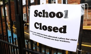 'School closed' sign on gate