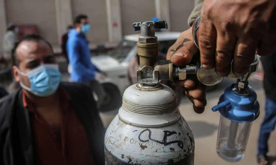 An oxygen cylinder is checked at the Gulf Gases Group factory in Nasr City oxygen cylinder before being sold to a customer whose relative is infected with Covid-19.
