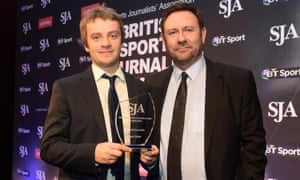 Daniel Taylor receives the Football Journalist of the Year prize at the SJA awards.