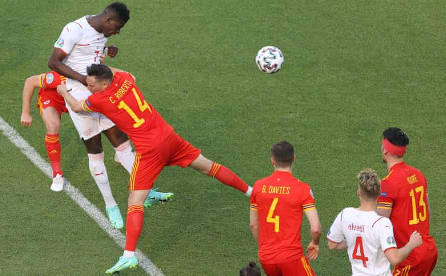 Breel Embolo gives Switzerland the lead despite the attentions of Wales's Connor Roberts