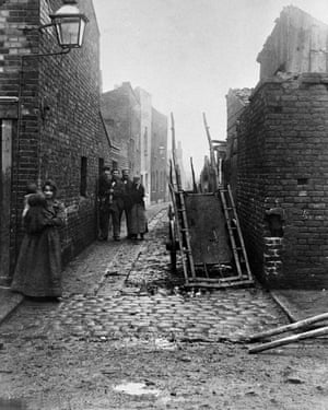 Slum housing in London, circa 1900. The eradication of extreme poverty is a key factor in controlling TB.