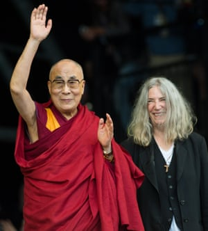 The Dalai Lama appears on stage with Patti Smith during her Glastonbury festival set on Sunday.