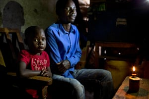 Michael Wandera Kwoba with his daughter Elizabeth Akumu Kwoba in Kibera