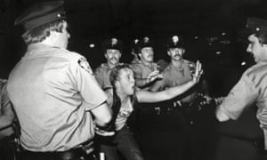 A protester faces up to police officers at the Stonewall Inn in New York in June 1969