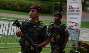 Malaysian military personnel patrol at the venue for the 27th Association of Southeast Asian Nations (ASEAN) Summit at the Kuala Lumpur Convention Centre .