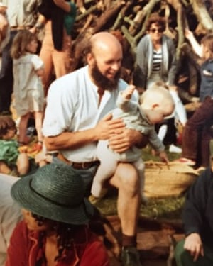 Michael Eavis with a baby Emily Eavis at the Glastonbury festival in 1980.