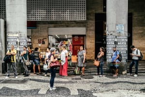 People waiting at a bus station in Rio Centro.