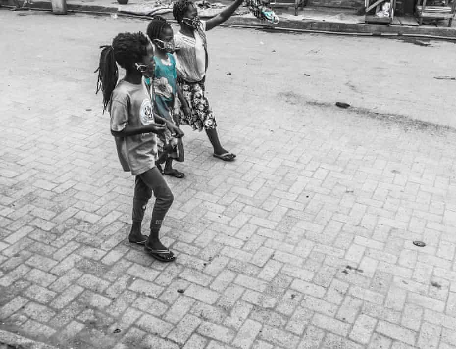 Children walk through the street in Orile.